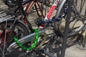 An example of how to lock up a bike well: a chain locks the front wheel and the frame to a fixed point, whilst a second chain locks the rear wheel to the frame.