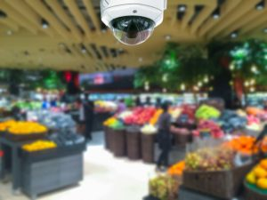 CCTV camera security in shopping mall with supermarket blur background.