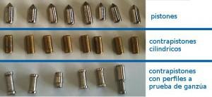 En la fila superior se muestran los pistones, en la fila del medio los contrapistones tradicionales de perfil cilíndrico, y en la fila inferior se pueden ver diferentes contrapistones con perfiles a prueba de ganzúa.